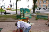 Artist and his painting of area in Old Quebec City.jpg