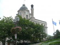 Building with green dome top and clock in Old Quebec City.jpg